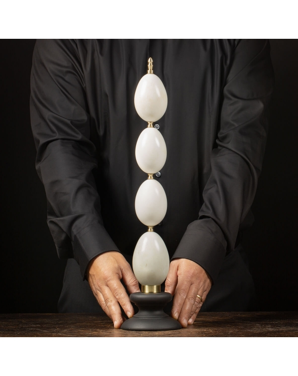 Duck eggs on a wooden and brass base