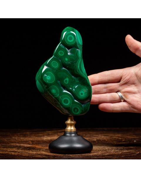 Malachite on wood and brass pedestal