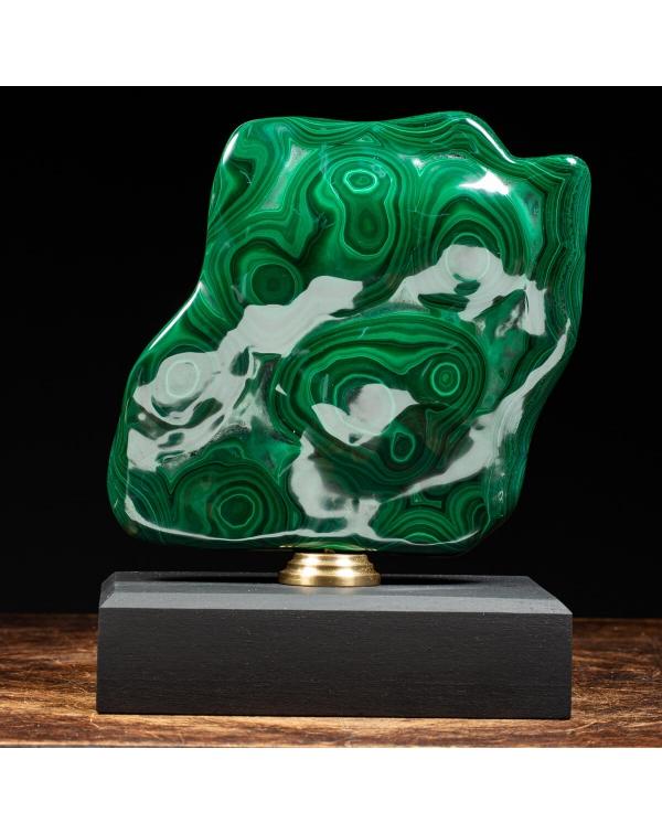 Malachite on wood pedestal with brass element